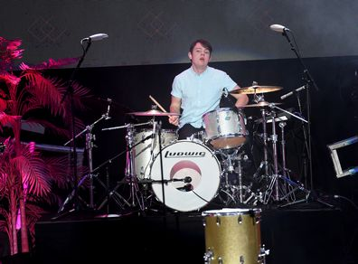 Graham Sierota performing, drums, on stage, band Echosmith