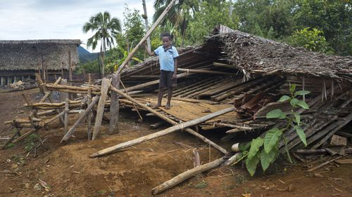 An undated handout photo made available on 23 March 2018 by UNICEF shows ten-year-old Stanton standing in the ruins of his home in Daga, Papua New Guinea. According to media reports, more than 140 people were killed and over 260,000 were left requiring emergency aid. EPA/THOMAS