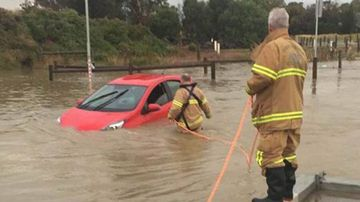 A woman had to be rescued from her car in Altona Meadows.