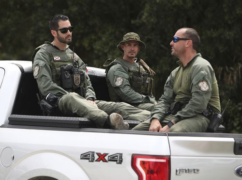 Law enforcement officers enter the T. Mabry Carlton Reserve in North Port Fl in a continued search for Brian Laundrie.