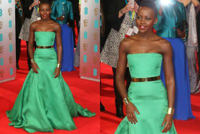 Talk about a pop of colour! Lupita wows the crowd with her emerald Dior gown...
