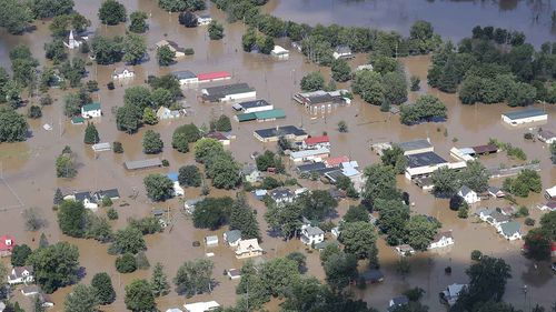 Torrential rains flooded the Kickapoo River to swamp the town of Gays Mills, Wisconsin.