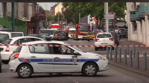 Police cordon off streets in Saint-Etienne-du-Rouvray. (AAP)