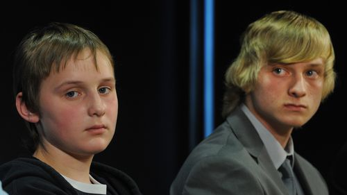 Sons of missing woman Belinda Peisley Billy Moffett (left), 14, and Cody Peisley, 16, and Belinda's father Mark Wearne attend a police press conference in Sydney in 2011.