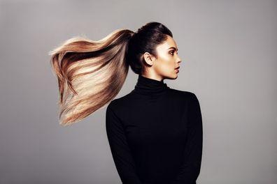 Woman flicking voluminous ponytail.