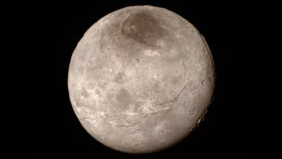 New Horizons photographed Pluto's moon Charon, which is named after the ferryman of the Greek underworld. <br /><br />The image shows a swathe of cliffs and troughs and a canyon estimated to be up to 9km deep. (NASA)