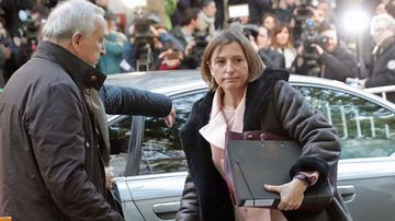 Catalan parliament speaker Carme Forcadell, (right) arrives at court. (Photo: AAP).