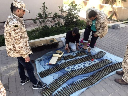 Fighters of a Misurata-based armed group, loyal to the UN-backed Government of National Accord of Fayez Serraj, prepare their ammunition before heading to the front line as battles (Photo by Stringer/picture alliance via Getty Images)