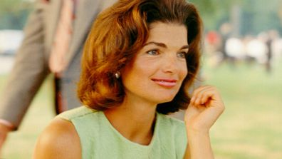 CIRCA 1960s:  Former First Lady Jacqueline Kennedy enjoys herself at a picnic circa the 1960s.