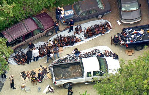 Authorities seized more than a thousand guns from an LA home after getting an anonymous tip regarding illegal firearms sales in a posh area near the Playboy Mansion.