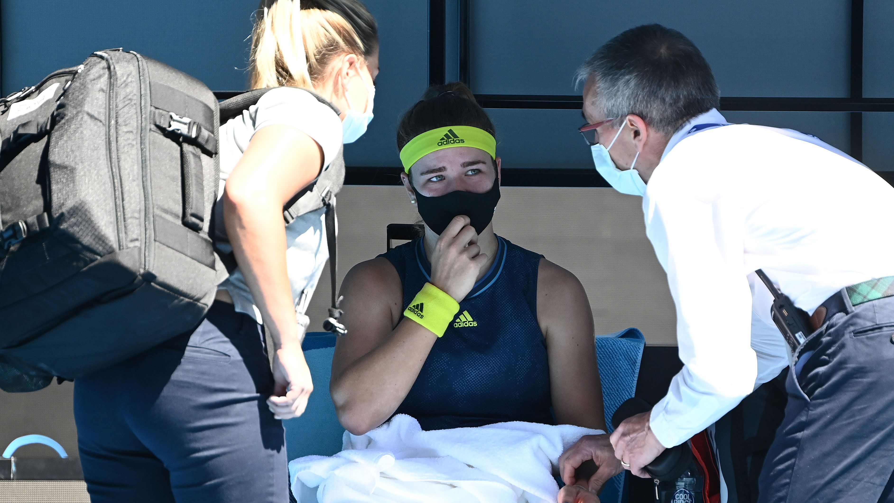 Karolina Muchova is seen to by medical staff during her match against Ash Barty.