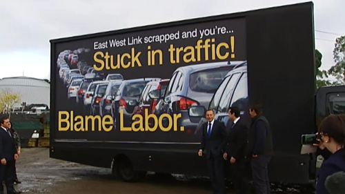 Victorian Premier Daniel Andrews calls out Prime Minister Tony Abbott over blame billboard