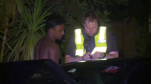 Police question the suspect in Mount Waverly last night.