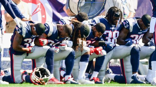 Patriots team members were booed for their actions. (AFP)