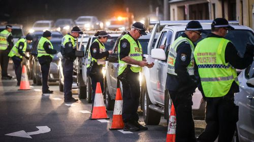 Police stop and question drivers at a checkpoint on July 8, 2020 in Albury, Australia.