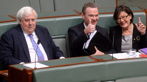 Palmer United Party leader Clive Palmer (left), leader of the house Chris Pyne and independent MP Cathy McGowan during House of Representatives question time at Parliament House Canberra on July 15, 2014.