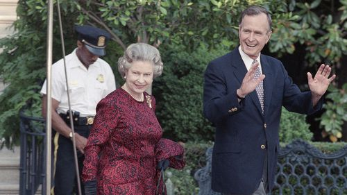 George H.W. Bush with The Queen.