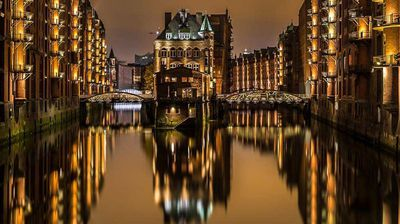 """German night-light: """"The photo was taken in Hamburg Harbour in late October on a photo road trip with my good friend Frank Sorensen. Our aim of the trip was to explore the city and its many exciting modern and historic buildings. My picture is taken from Poggenmuhle bridge in the old part of Hamburg Harbour called Speicherstadt and shows the known 'Wasserscholss'."""" Kaare Bak, winner, Denmark, National Award, 2015 Sony World Photography Awards."""