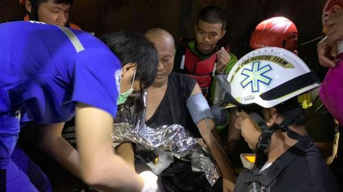 Medics provide treatment to the monk after Phra Ajarn Manas' rescue.