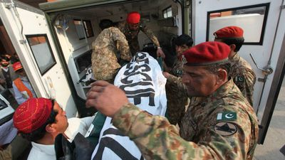 Pakistani soldiers shift bodies of the victims who were killed. (Getty Images) <br> <br> Witnesses say a huge blast rocked the city before at least six Taliban gunman attacked the school, going door to door.
