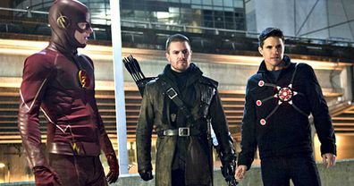Grant Gustin as The Flash, Stephen Amell as Green Arrow and Robbie Amell as Firestorm on CW's hit superhero series