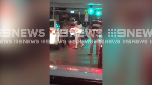 The taxi driver is seen being punched repeatedly as he tries to get away. (9NEWS)