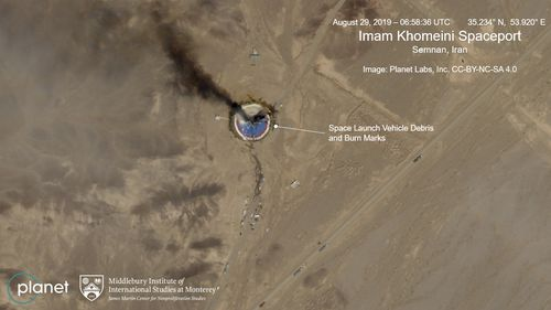This Thursday Aug. 29, 2019, satellite image from Planet Labs Inc., shows a fire at a rocket launch pad at the  Imam Khomeini Space Center in Iran's Semnan province. (Planet Labs Inc, Middlebury Institute)
