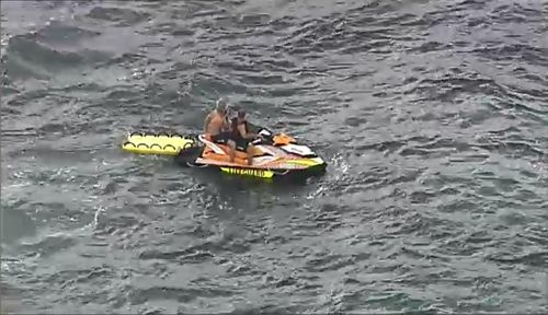 Cronulla lifeguards were the first to arrive to the upturned boat before the Westpac Life Saver Rescue Helicopter was deployed. Picture: 9NEWS.
