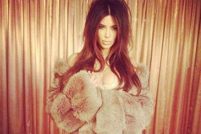 Throwback! Kim poses in fur for a vintage lingerie shoot....hopefully that's faux, Miss K.