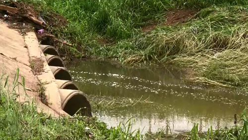 Townsville floods bodies found stormwater drain