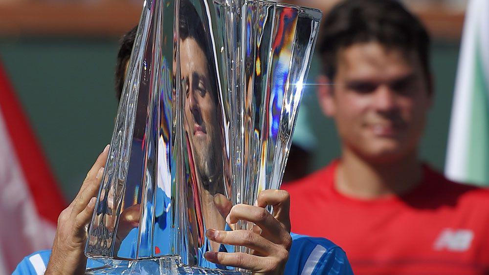 Novak Djokovic lifts the trophy at Indian Wells. (AAP)