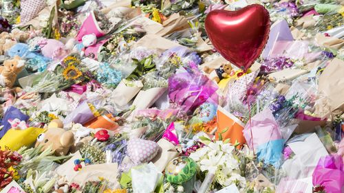 The site of the attack was inundated with floral tributes in the days following. (Getty)