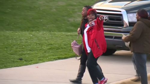 Students leave the school after the lockdown is lifted. (9NEWS)