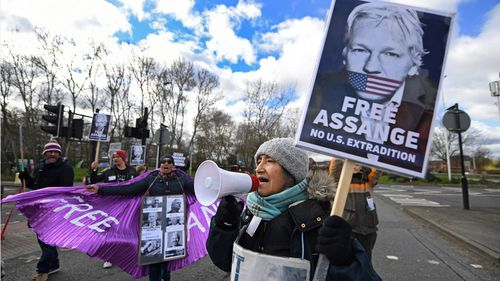 Julian Assange supporters protest outside Woolwich Crown Court in London, Britain, 26 February 2020.
