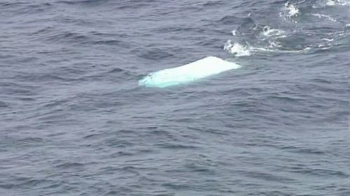 A 6-metre vessel is believed to have flipped over while carrying five passengers - three men aged 18, 29 and 46, and three 13-year-old children. Picture: 9NEWS.