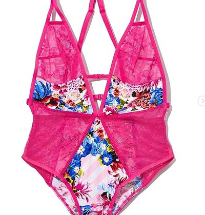 The bright pink, floral teddy available in the new <em>VS Loves Mary Katrantzou</em> collection.