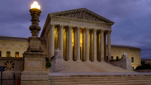 The US Supreme Court building stands quietly before dawn in Washington on Friday, October 5.
