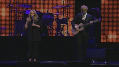 Kylie Minogue and Ed Sheeran on stage at Michael Gudinski memorial at Rod Laver Arena
