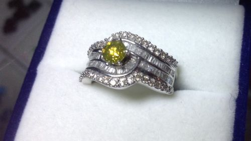 A yellow diamond ring was among the items stolen. (Victoria Police)