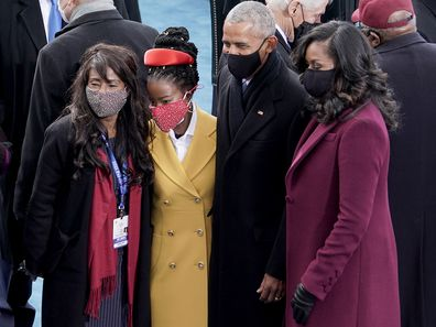 Amanda Gorman, center, takes a photo with former president Barack Obama and Michelle Obama prior to the 59th Presidential Inauguration
