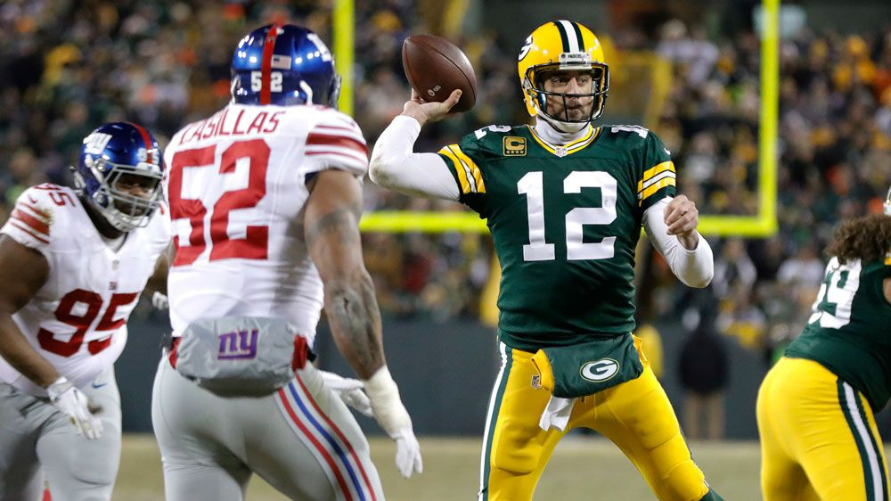 Packers, Steelers advance with NFL playoff romps
