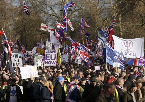"""People attend the """"Brexit Betrayal Rally"""", a pro-Brexit rally, on Park Lane in London. MPs are to vote on the EU withdrawal agreement on Tuesday."""