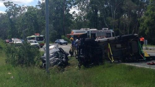 Family trapped, five in hospital after Brisbane car crash