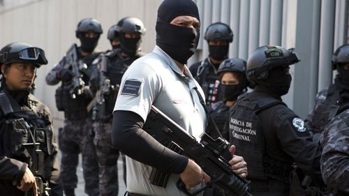 "Security agents guard a gate to the attorney general's office for organised crime as a convoy arrives carrying Damaso Lopez, nicknamed ""El Licenciado,"" in Mexico City last year. Mexican prosecutors said they captured Lopez, one of the Sinaloa cartel leaders who launched a struggle for control of the gang following the re-arrest of Joaquin ""El Chapo"" Guzman. Lopez was long considered Guzman's right-hand man and helped him escape from a Mexican prison in 2001."