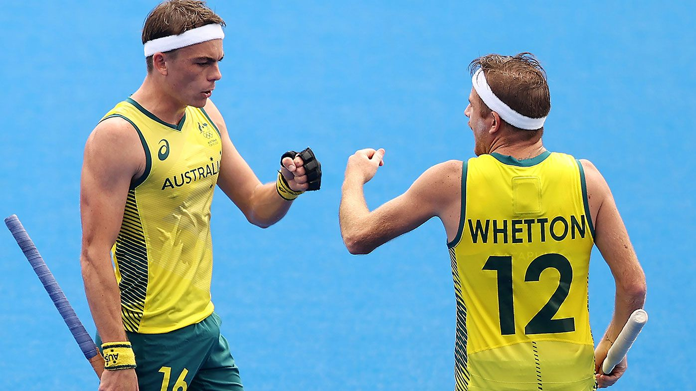 Tim Howard and Jacob Thomas Whetton of Team Australia fist bump during the Men's Preliminary Pool A match between Australia and Argentina on day four of the Tokyo 2020 Olympic Games at Oi Hockey Stadium on July 27, 2021 in Tokyo, Japan. (Photo by Francois Nel/Getty Images)