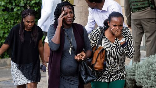 People in shock as they flee a Nairobi hotel under attack.