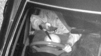 This individual was photographed eating behind the wheel while on his phone.