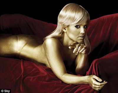 After losing a ton of weight this year, the reality star stripped down to her undies and covered herself from head to toe in gold body paint, to recreate the famous scene from <i>Goldfinger</i> where Bond Girl Jill Masterson dies on a red sofa.
