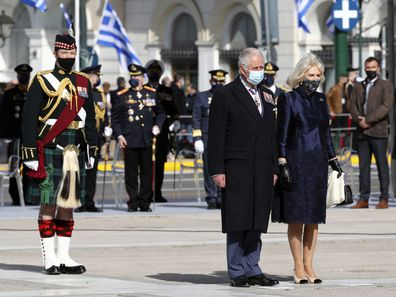 Prince Charles, front left, and his wife Camilla, the Duchess of Cornwall arrive to lay a wreath at the tomb of the Unknown Soldier in Athens, Thursday, March 25, 2021.