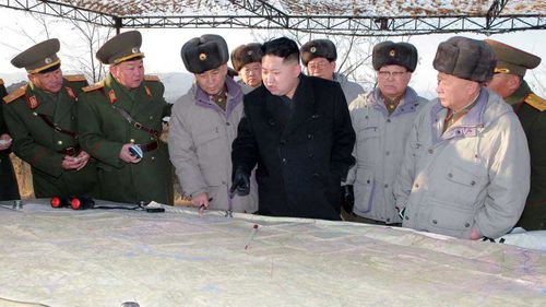Kim Jong-un surveys a map surrounded by his generals. (KCNA)